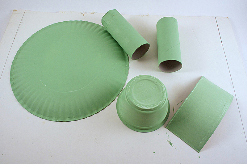 Paint the paper plate, cardboard tubes and other items light green