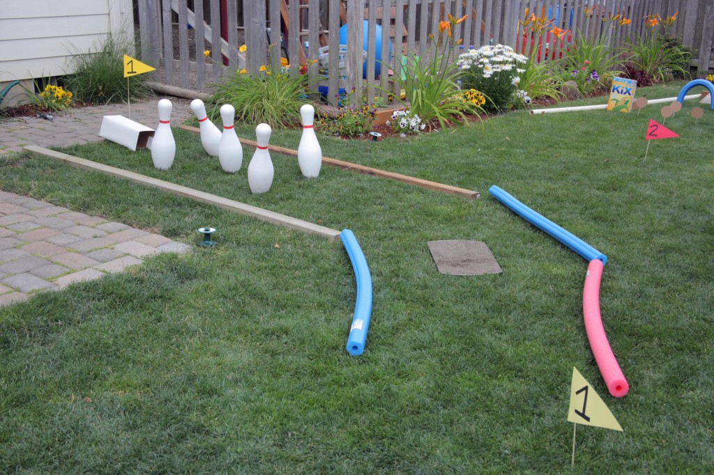 DIY Mini Golf Course in the backyard - it has a sand trap!