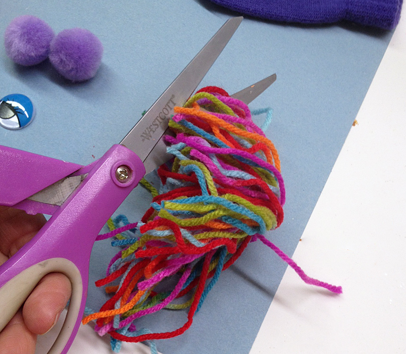 then cut yarn to create hair fray